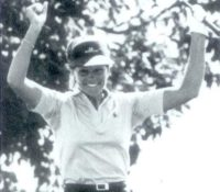 Younger Sally Little raising her arms in joy