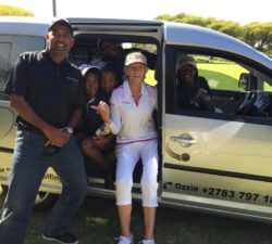 Sally Little and an instructor in a shuttle with the kids