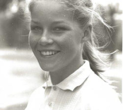 Younger Sally Little smiling at the camera