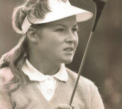 Younger Sally Little's focus face while holding a club