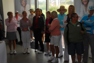A line of women standing inside the clinic