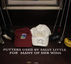 Putters used by Sally Little for many of her wins along with hats